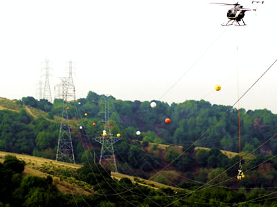 Many marking spheres is installed on the highest wire in the color of red, yellow and white.